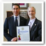 Michael Kaplen, President, Brain Injury Association of New York State, receiving a proclamation establishing Brain Injury Awareness Day from Suffolk County Legislature Majority Leader, Jon Cooper