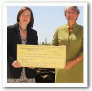 Shana De Caro, Treasurer of the American Association for Justice, Traumatic Brain Injury Litigation Group, presents Susan Connors, Executive Director of the Brain Association of America, with 2010 brain injury prevention and education, endowment donation.